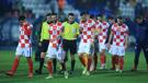 Dejected Croatian players leave the pitch
